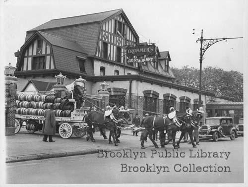 View of horse-drawn wagon or truck carrying barrels of Trommer beer, in foreground, and Trommer's Restaurant in Ridgewood. Credit: Brooklyn Public Library, Brooklyn Collection